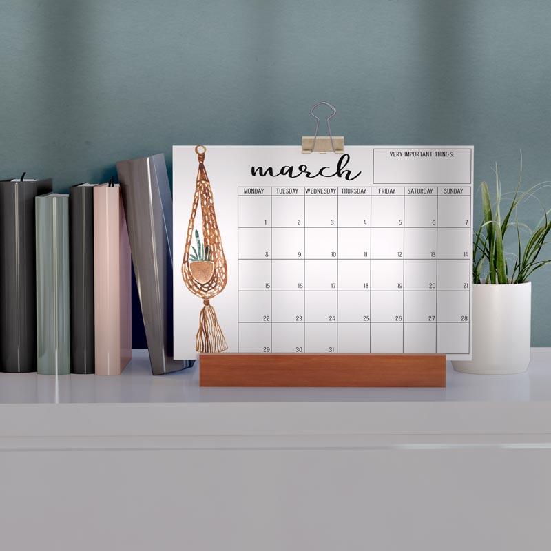 A printable plant-themed calendar on a desk.